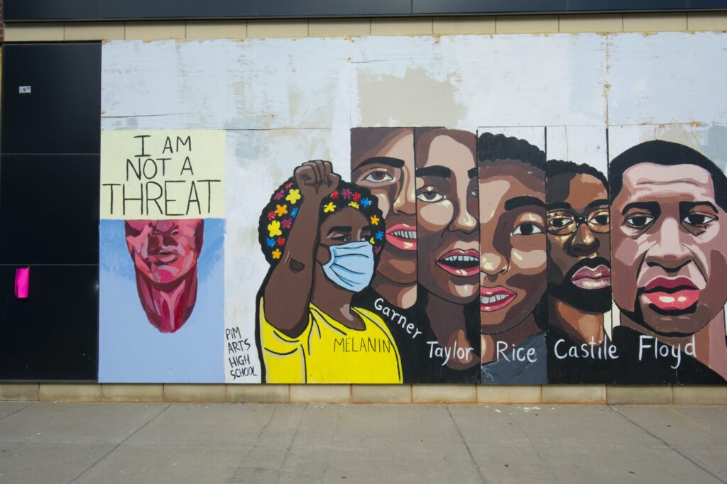 Mural on boarded up windows in Uptown, Minneapolis. By PiM Arts High School